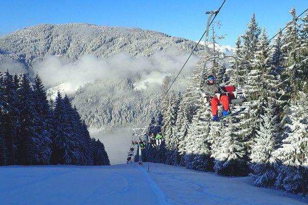 Zon stoeltjeslift, dal wolken
